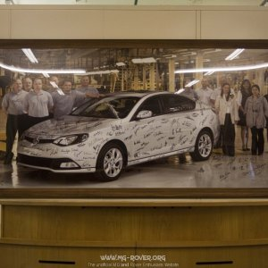 Picture of MG6 behind reception desk for the assembly hall at MG Birmingham